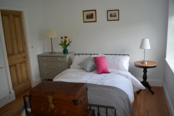 The lovely comfy double bed with crisp, white linen